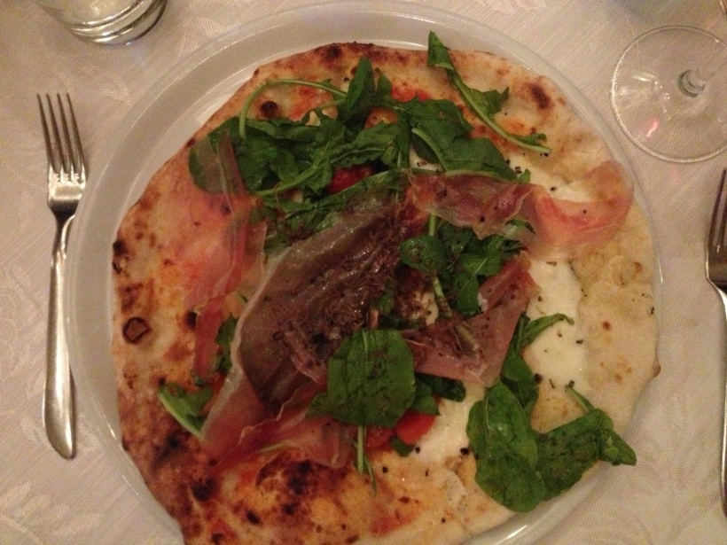 After meeting up with Caroline in Florence, we had an epic dinner. Epic because I ate this entire pizza topped with prosciutto, arugula, and fresh mozzarella.